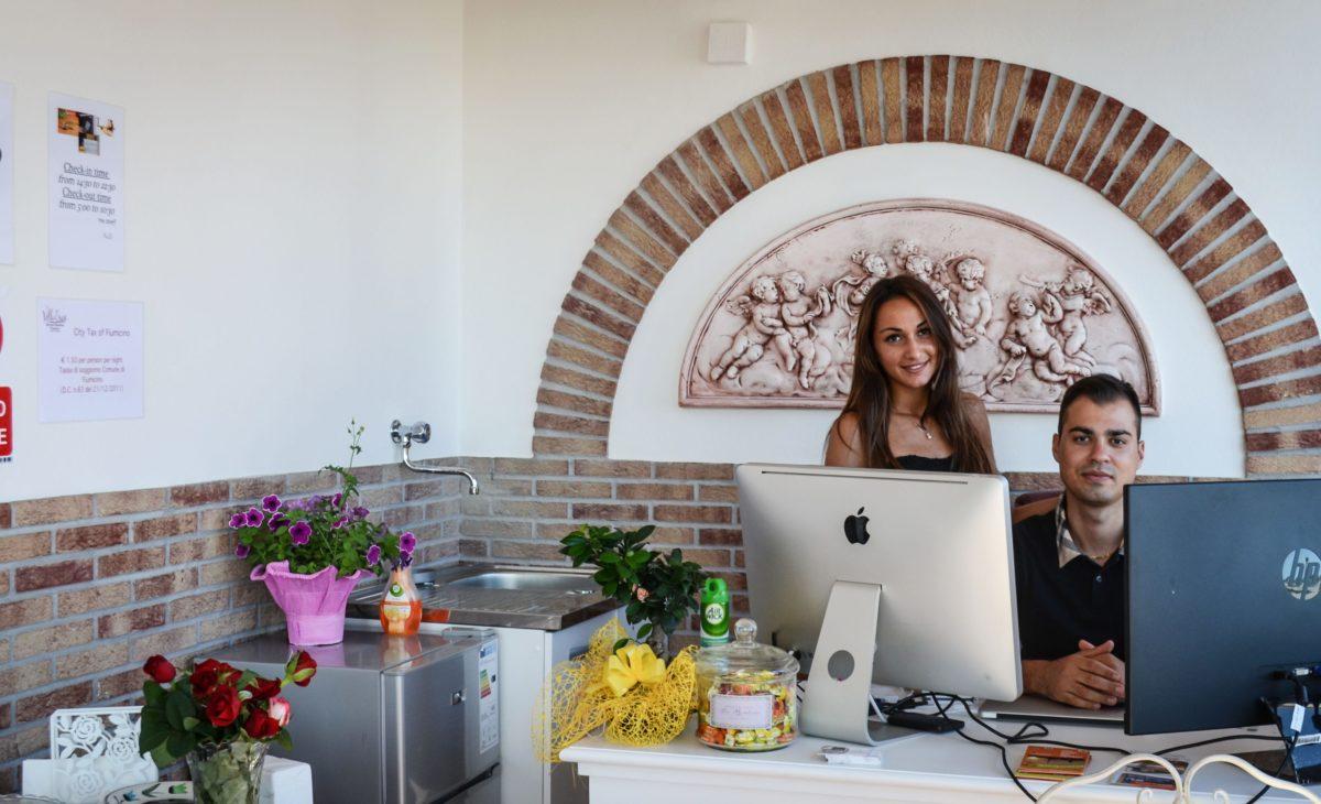 https://www.villaerasi.com/wp-content/uploads/2020/03/Villa-Erasi-reception-staff-min-1200x730.jpg